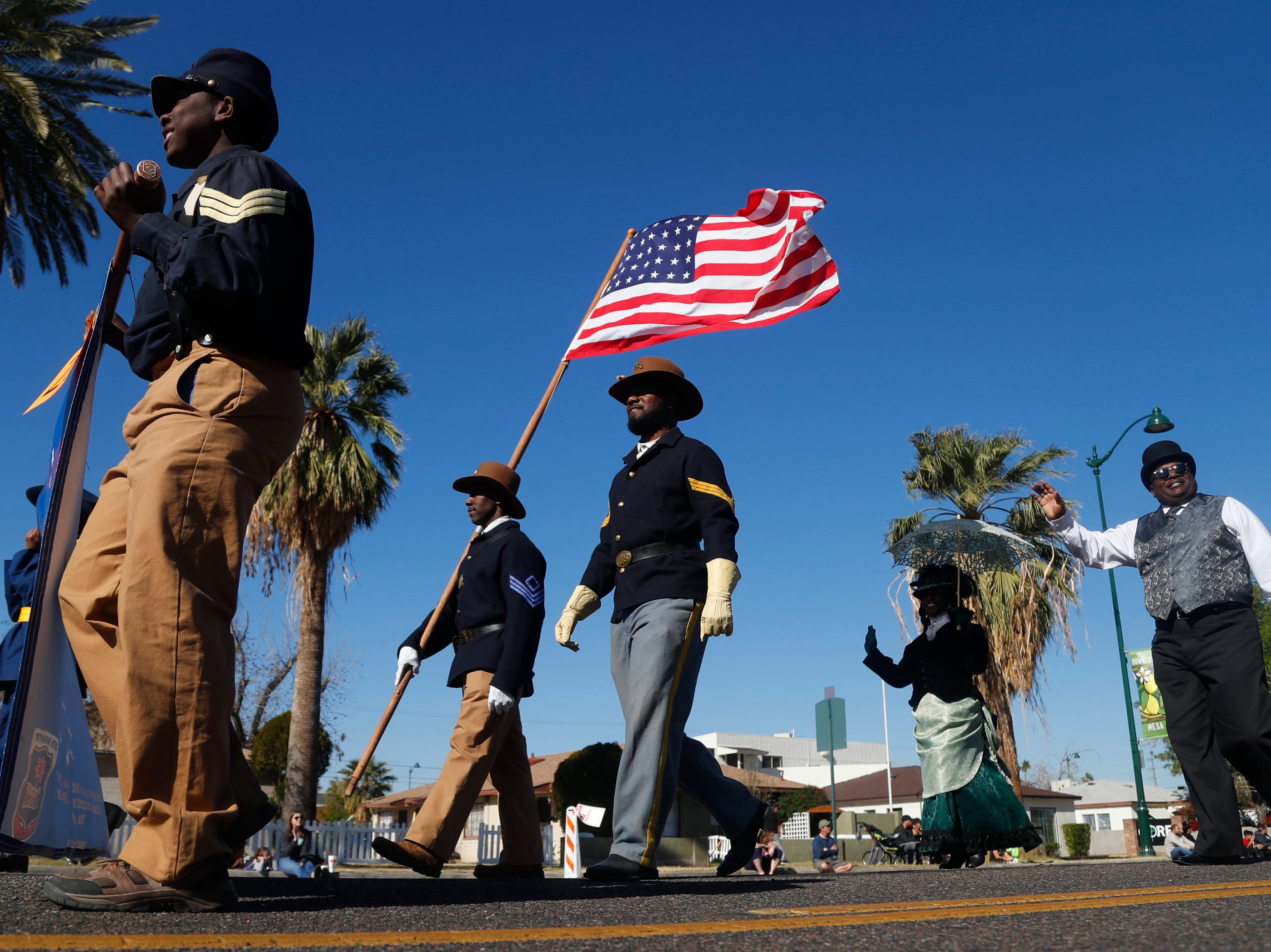 Buffalo Soldiers of Arizona come down the parade route during the MLK Day Parade in Mesa, Ariz.