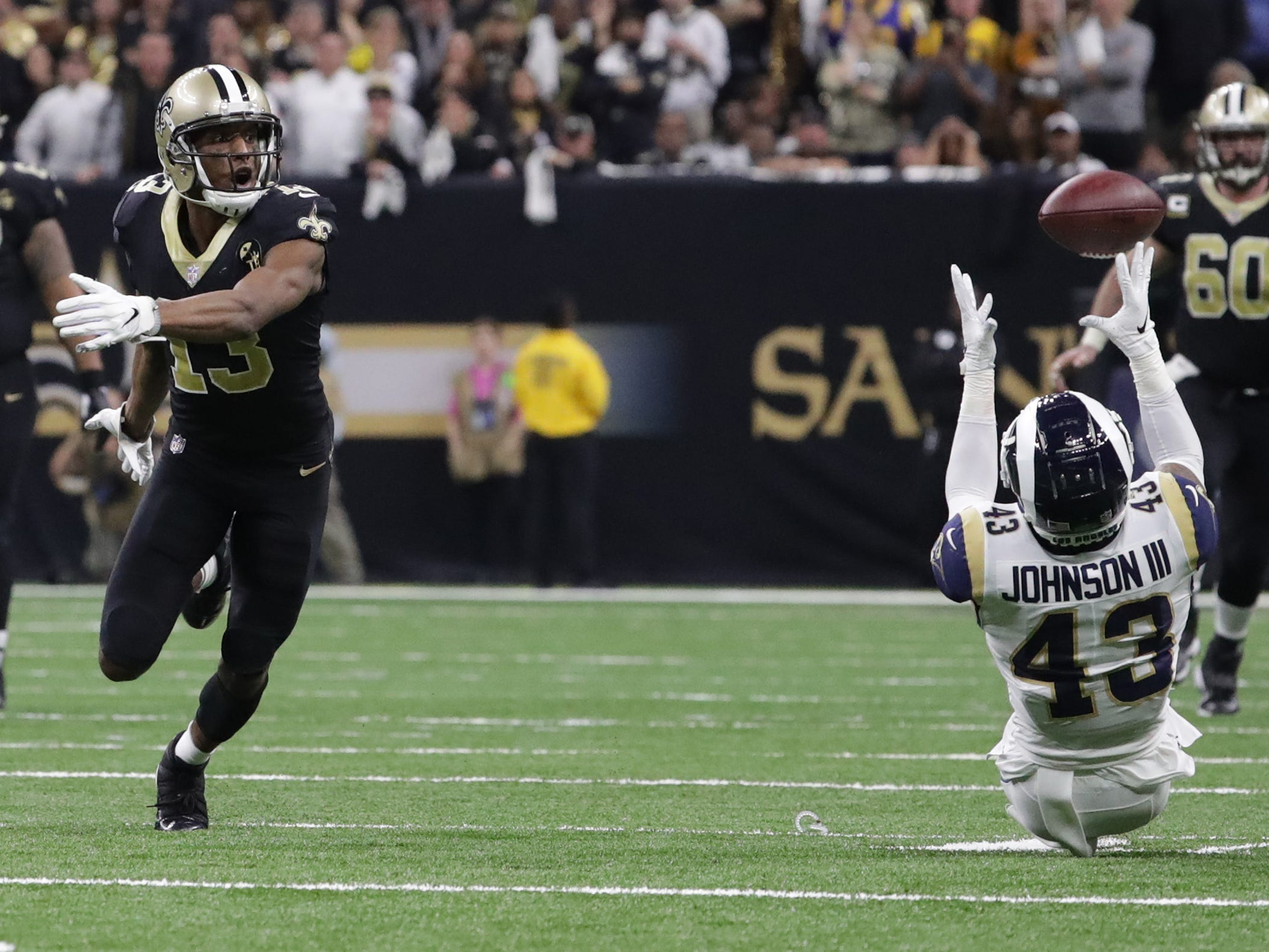 Conference championships: Los Angeles Rams strong safety John Johnson intercepts a tipped pass in overtime of a 26-23 win over the New Orleans Saints in the NFC Championship at Mercedes-Benz Superdome.
