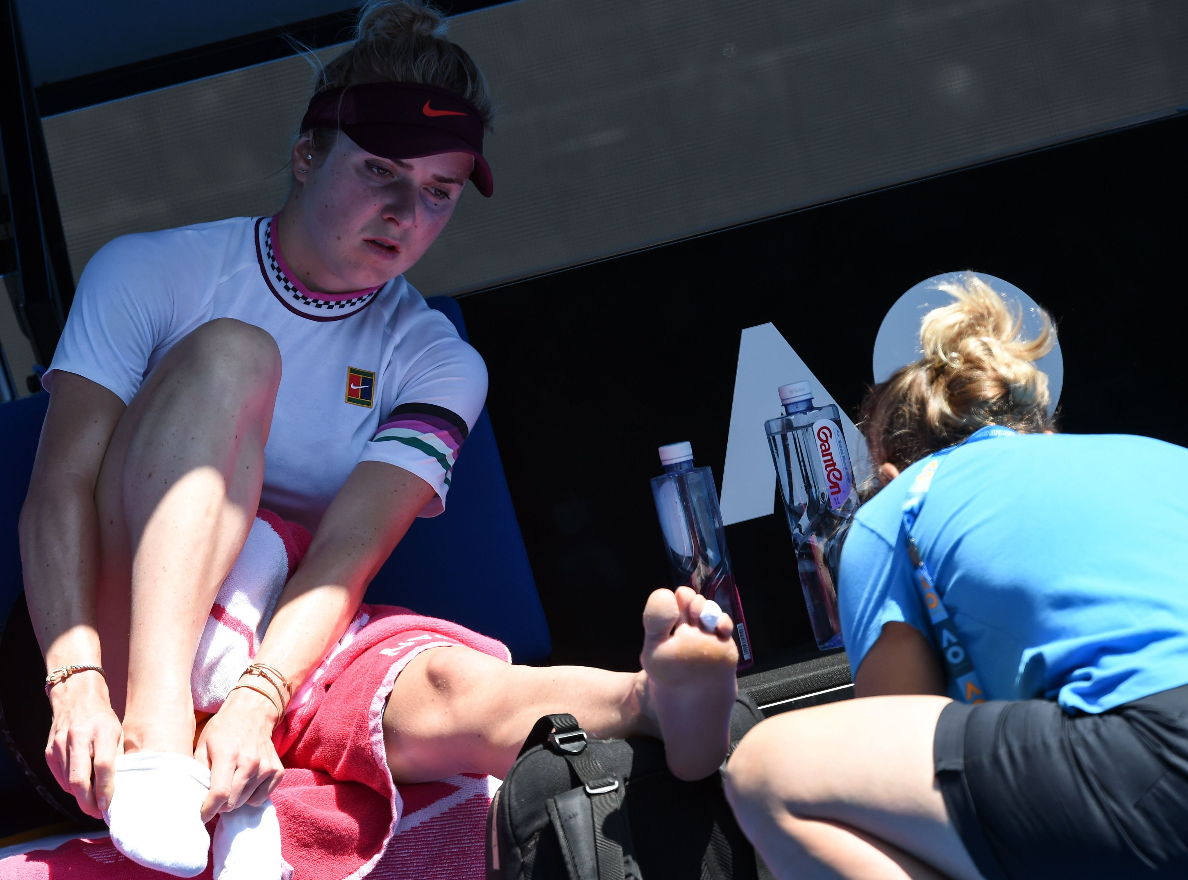 Ukraine's Elina Svitolina gets medical treatment on her foot during her Round of 16 match against American Madison Keys.