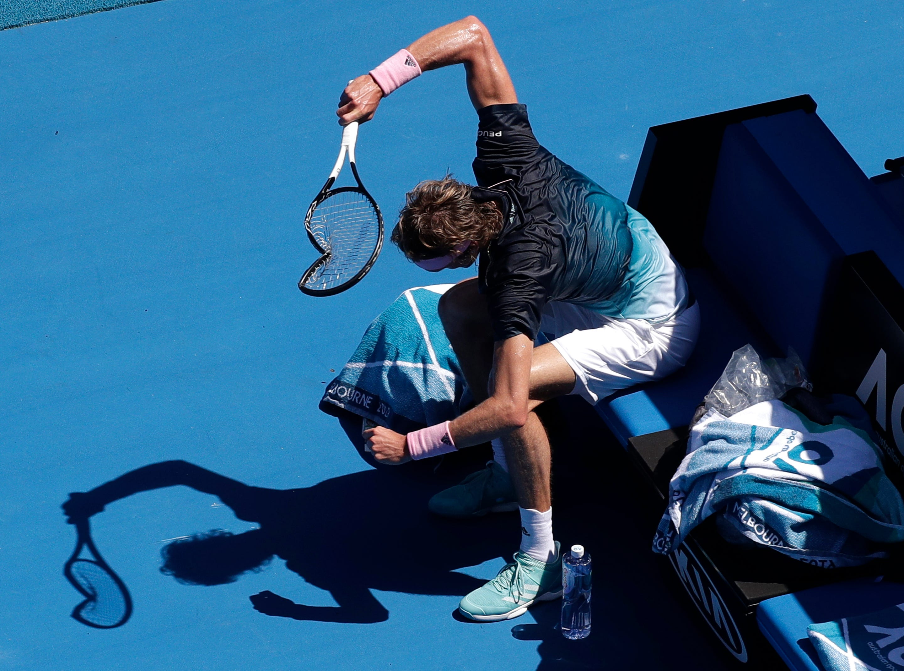 Alexander Zverev smashes his racket in frustration during his fourth-round match against Milos Raonic at the Australian Open.