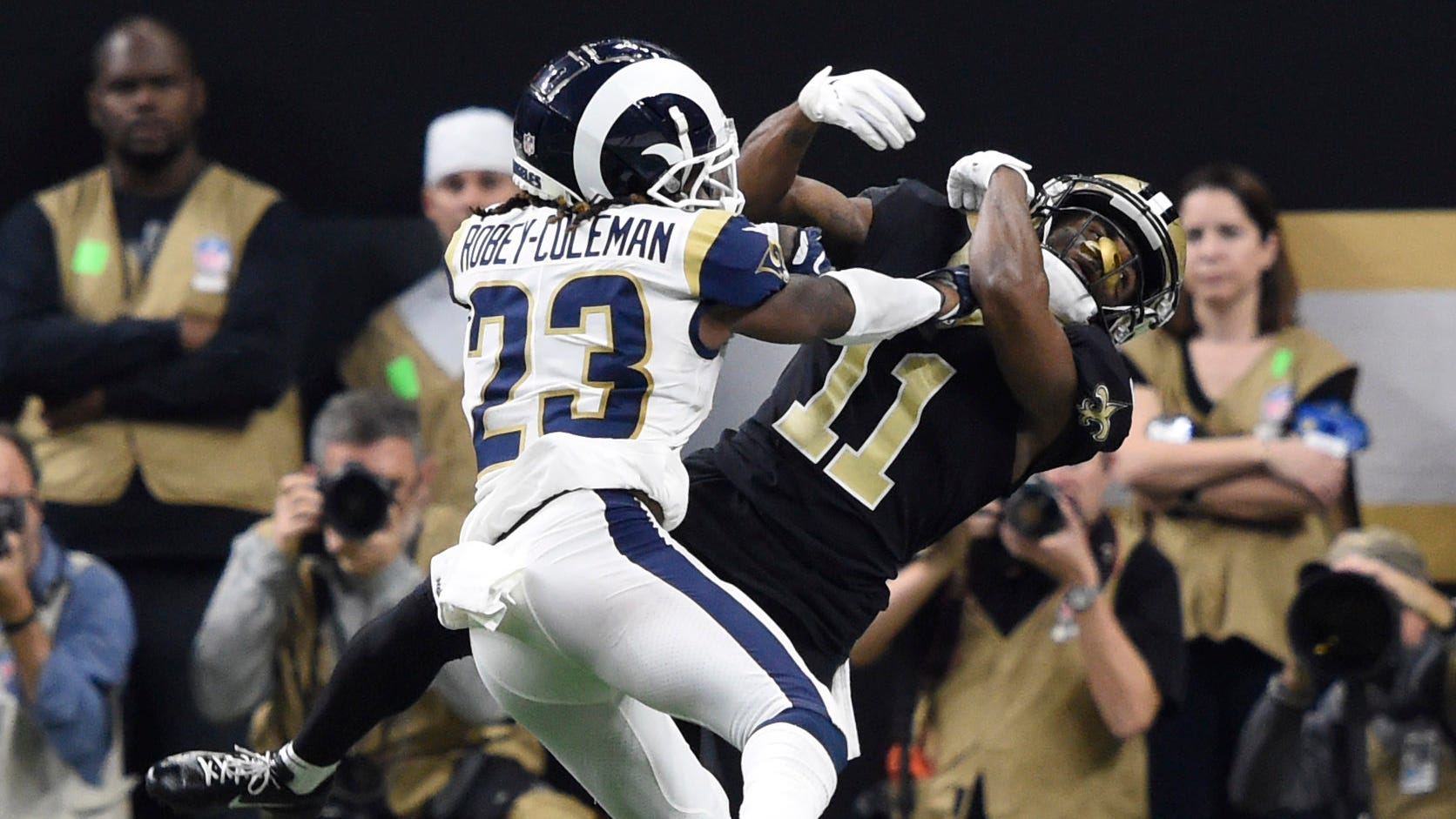 Rams defensive back Nickell Robey-Coleman (23) breaks up a pass intended for Saints wide receiver Tommylee Lewis (11).