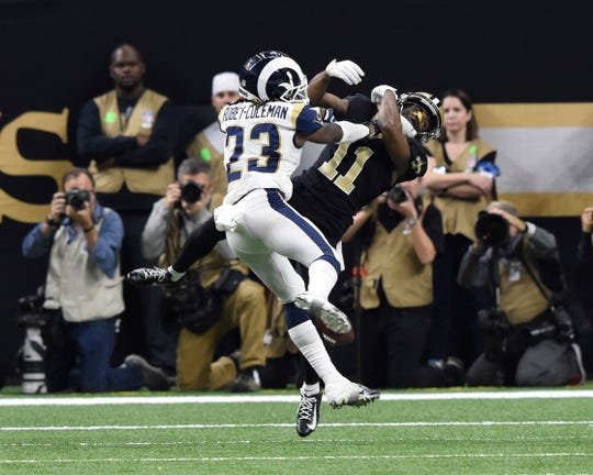 Rams defensive back Nickell Robey-Coleman (23) hits Saints wide receiver Tommylee Lewis (11)  that became a crucial no-call when it appeared there was pass interference.