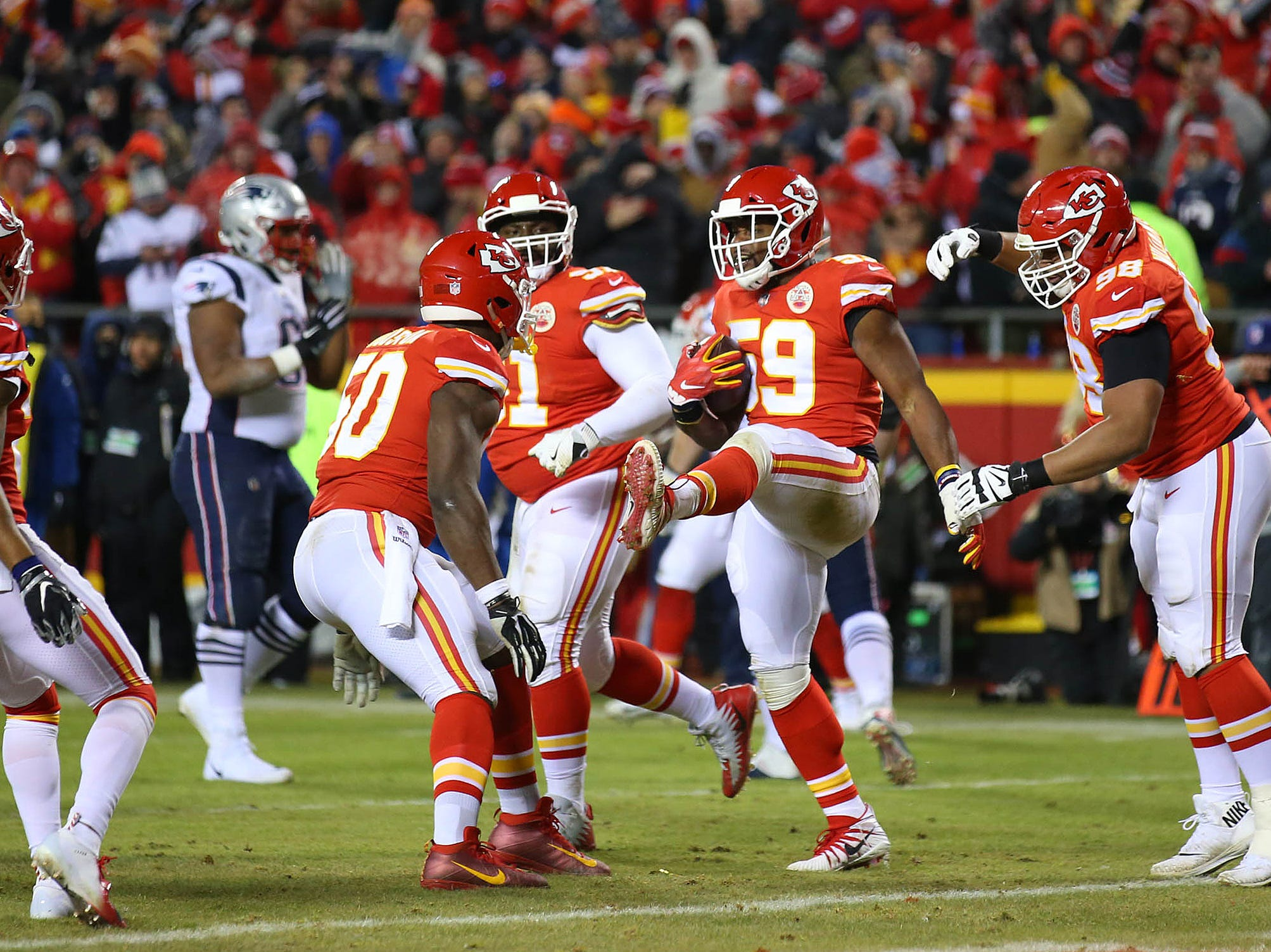 Kansas City Chiefs inside linebacker Reggie Ragland (59) celebrates with teammates after intercepting a pass against the New England Patriots.