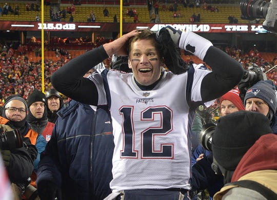 Patriots quarterback Tom Brady (12) reacts after defeating the Chiefs during overtime in the AFC Championship game at Arrowhead Stadium.