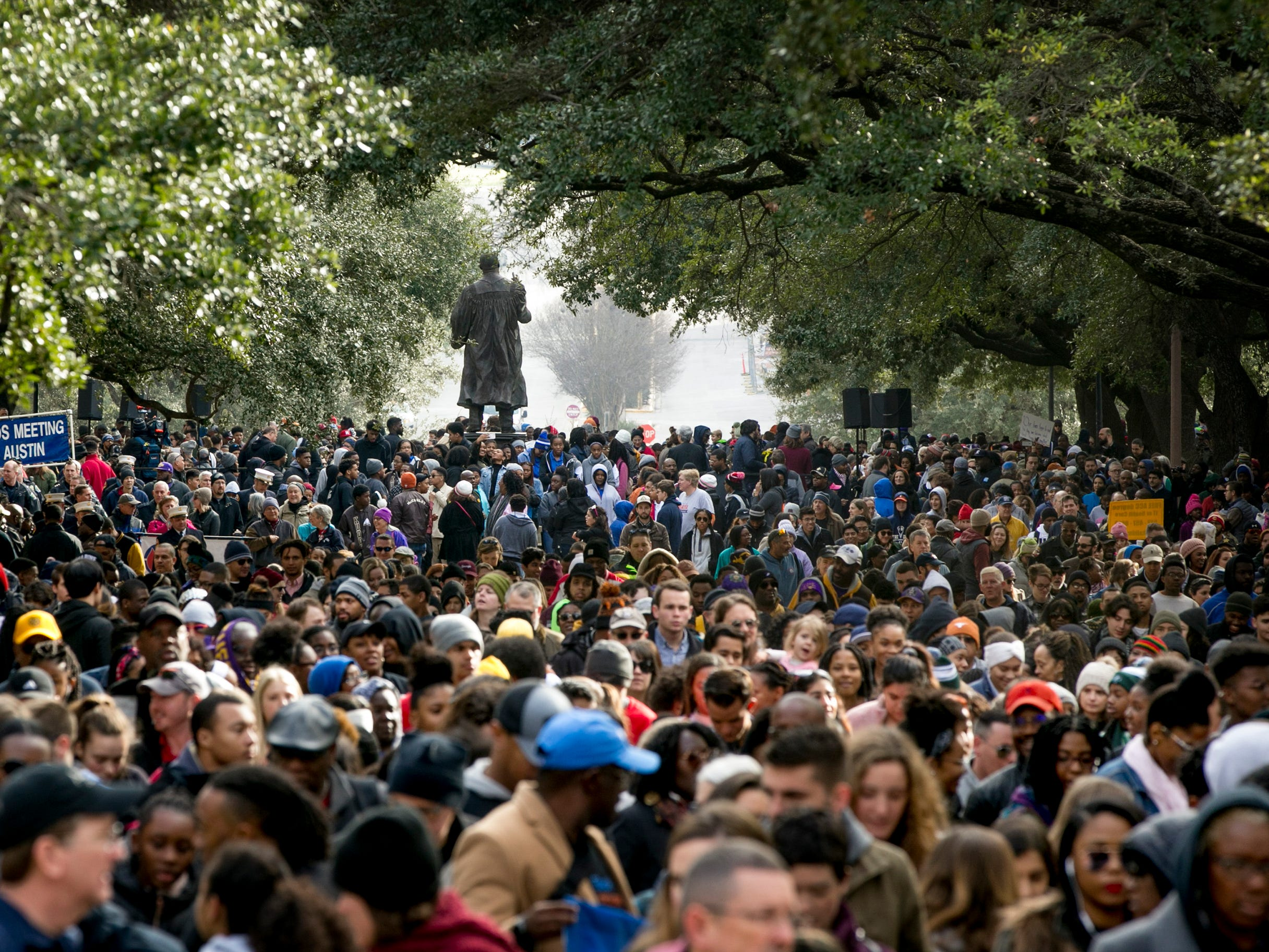 Thousands gather at the MLK statue on the University of Texas at Austin campus during the MLK March and Festival.