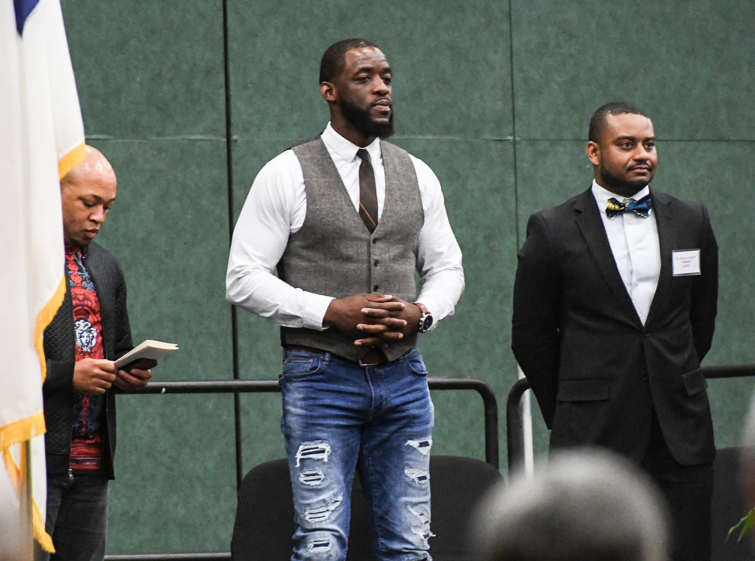 Rev. Lenny Gaines, left, of PowerHouse Christian Church, Cyrus Birch of Charleston, middle, an stunt performer as a Jabari warrior in Marvel Studio's Black Panther, and Dr. Ankoma Anderson, right, of Welfare Baptist Church, during the Anderson County Martin Luther King, Jr. Celebration in Anderson January 21, 2019.
