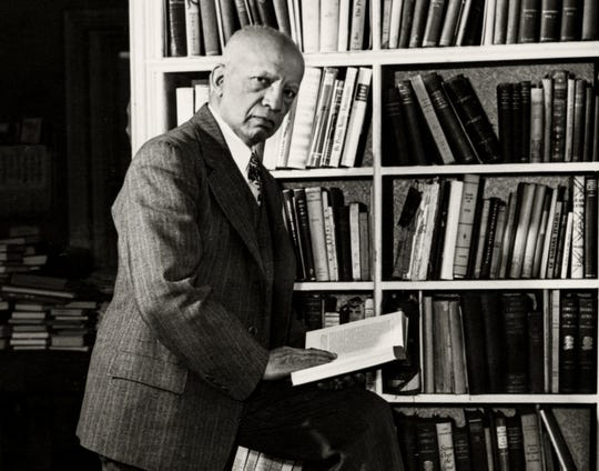 Dr. Carter G. Woodson is photographed in a Washington library in February 1948. (Gannett, Robert S. Scurlock/National Museum of American History/File)