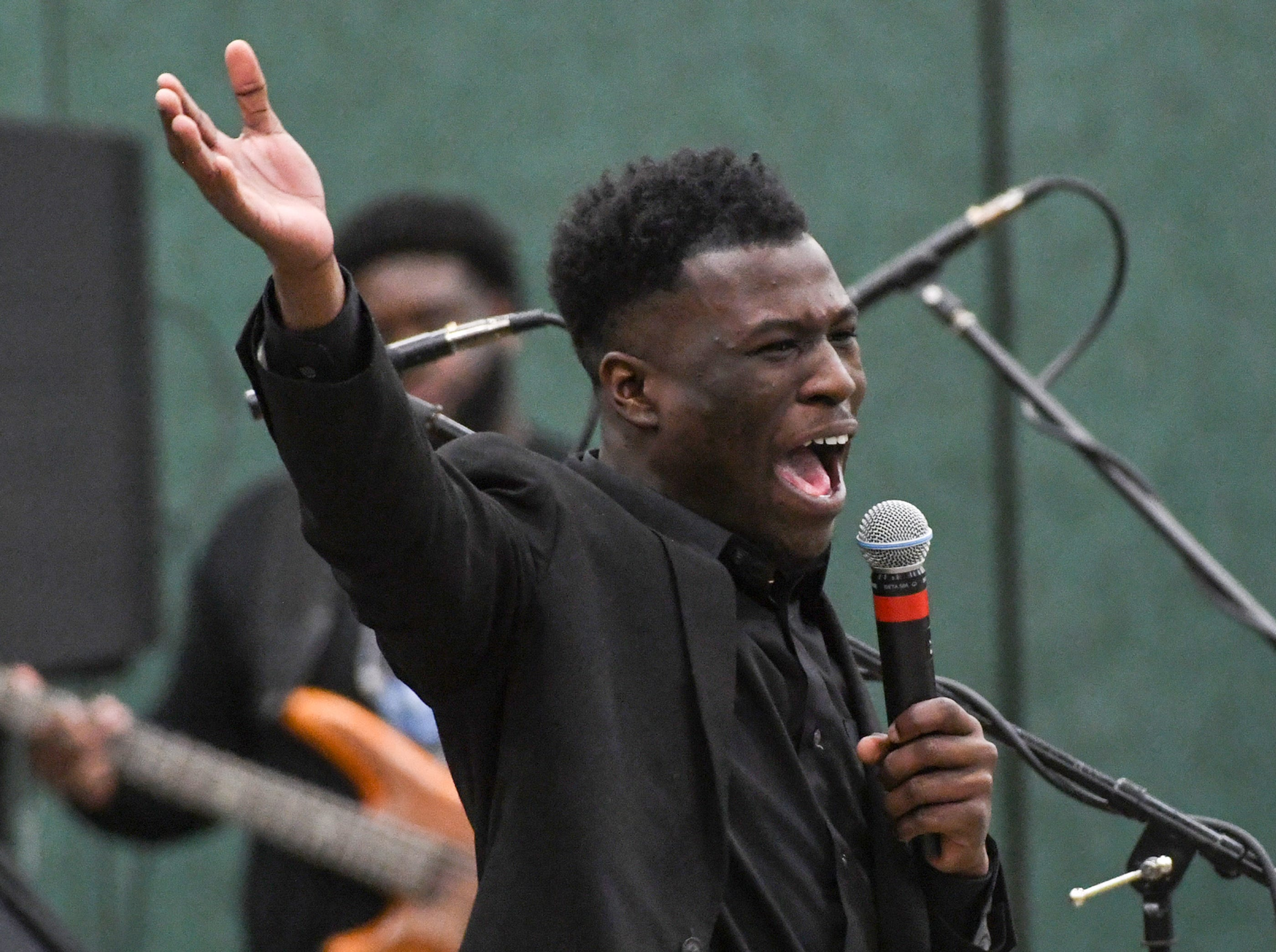 """Malek McDuffie leads """"Lift Every Voice and Sing"""" during the Anderson County Martin Luther King, Jr. Celebration in Anderson January 21, 2019. This yearÕs keynote speaker is Cyrus Birch, Charleston native and community activist, who works as a model and stunt performer, seen as a Jabari warrior in the megahit ÒBlack Panther.Ó"""