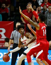 Nebraska Cornhuskers forward Isaac Copeland Jr. (14) and forward Tanner Borchardt (20) defend against Nebraska Cornhuskers forward Isaiah Roby (15)