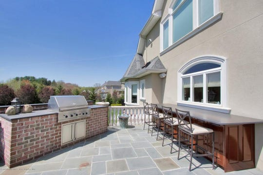 The home offers a raised bluestone patio with built-in BBQ on the patio.