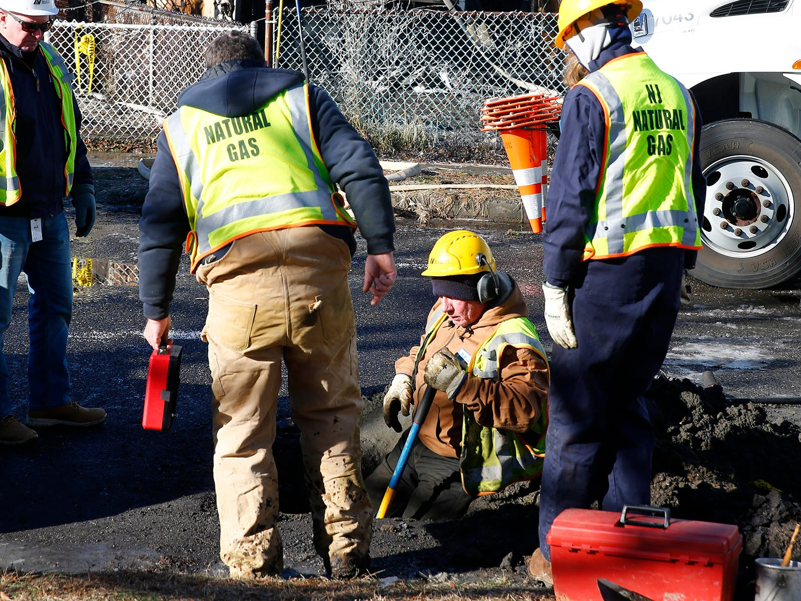 A New Jersey Natural Gas crew works on lines in front of a Cottage Place home in Keansburg Tuesday morning, January 22, 2019, that was gutted by a fire.