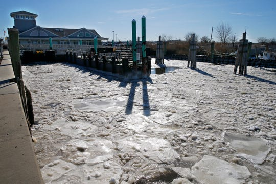 Ice fills the slips at the Belford ferry terminal Tuesday morning, January 22, 2019.
