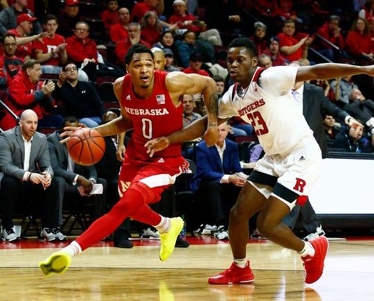 Nebraska Cornhuskers guard James Palmer Jr. (0) drives to the basket against Rutgers Scarlet Knights guard Montez Mathis (23)