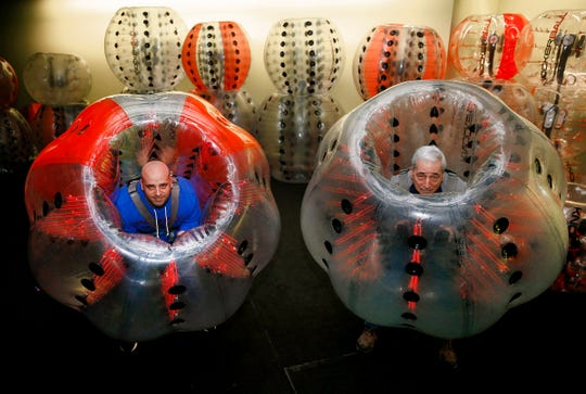 Knockerball & More owners Mike and his father John Cannizzaro get geared up in their facility at the Monmouth Mall in Eatontown Tuesday, January 22, 2019.