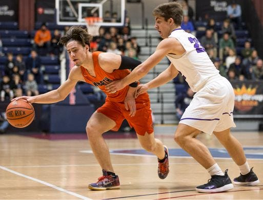 Middletown North's Rob Higgins drives against Rumson -Fair Haven at Brookdale Community College in Middletown.