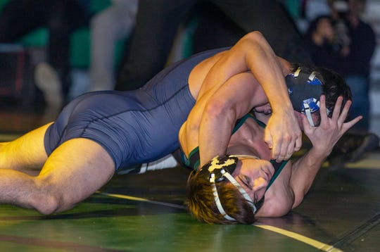 Howell's Paul Jakub (top) pins South Plainfield's Marc Giordano in the Rebels' 30-28 win on Jan. 17