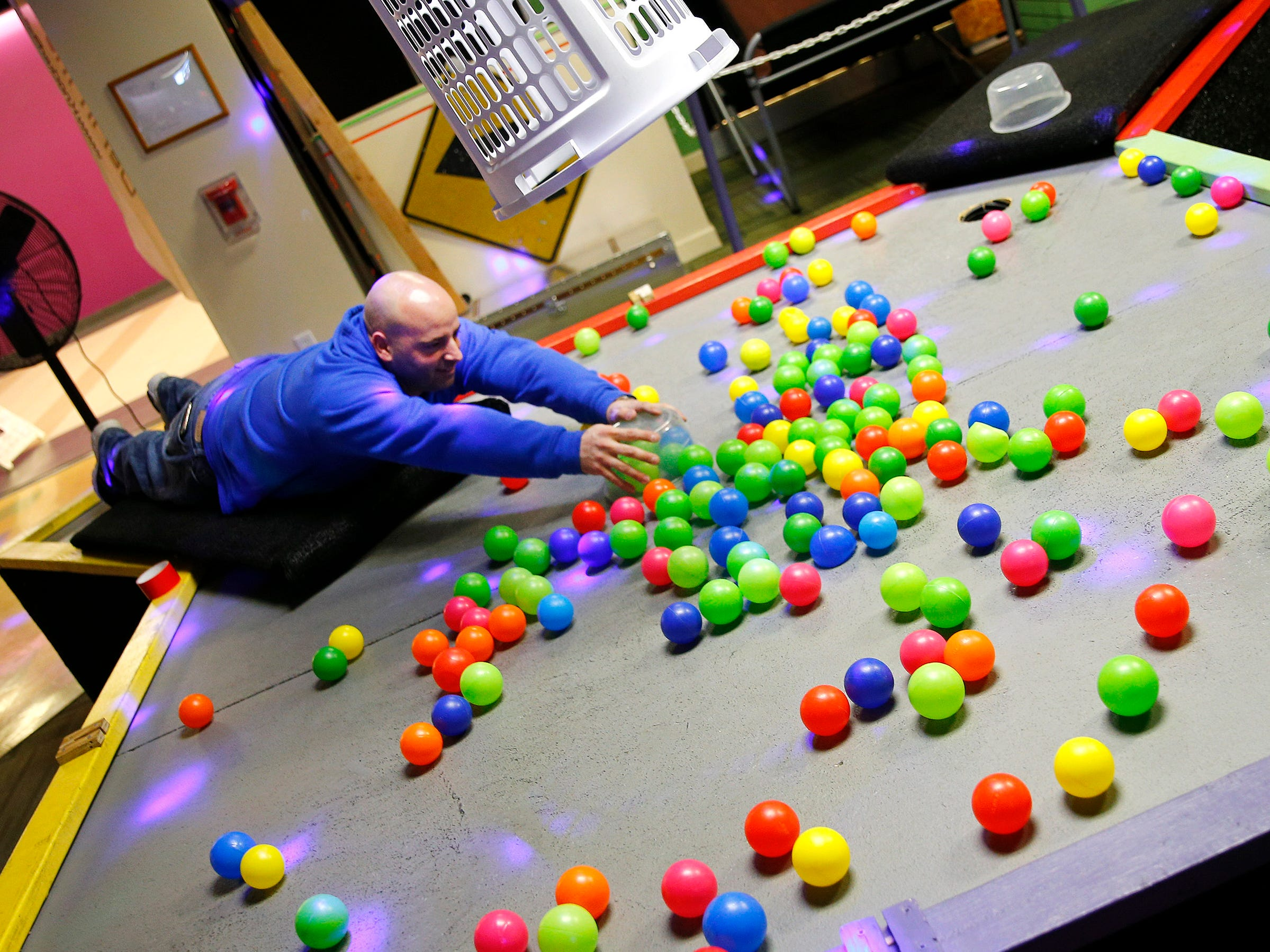 """""""Knockerball & More"""" co-owner Mike Cannizzaro demonstrates the """"Hungry, Hungry Human"""" game at the Monmouth Mall facility in Eatontown Tuesday, January 22, 2019."""