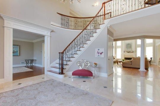 The home features a grand two-story entrance foyer with wonderful open floor plan.