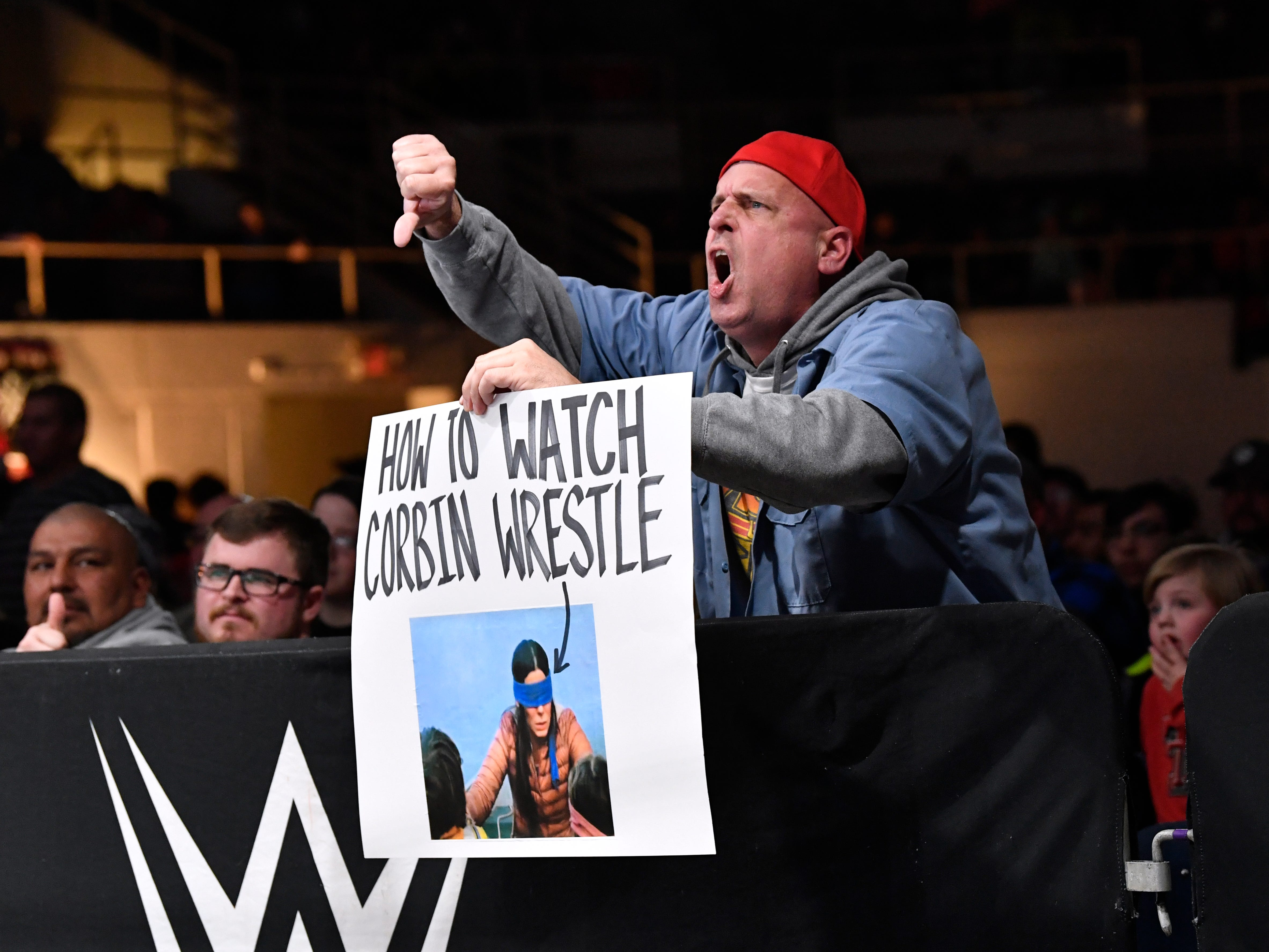 A fan taunts Baron Corbin with a homemade sign during Saturday's WWE Live wrestling event Jan. 19, 2019. Held at the Taylor County Coliseum, the evening featured a colorful array of World Wrestling Entertainment stars, including Mixed Martial Arts fighter Ronda Rousey.