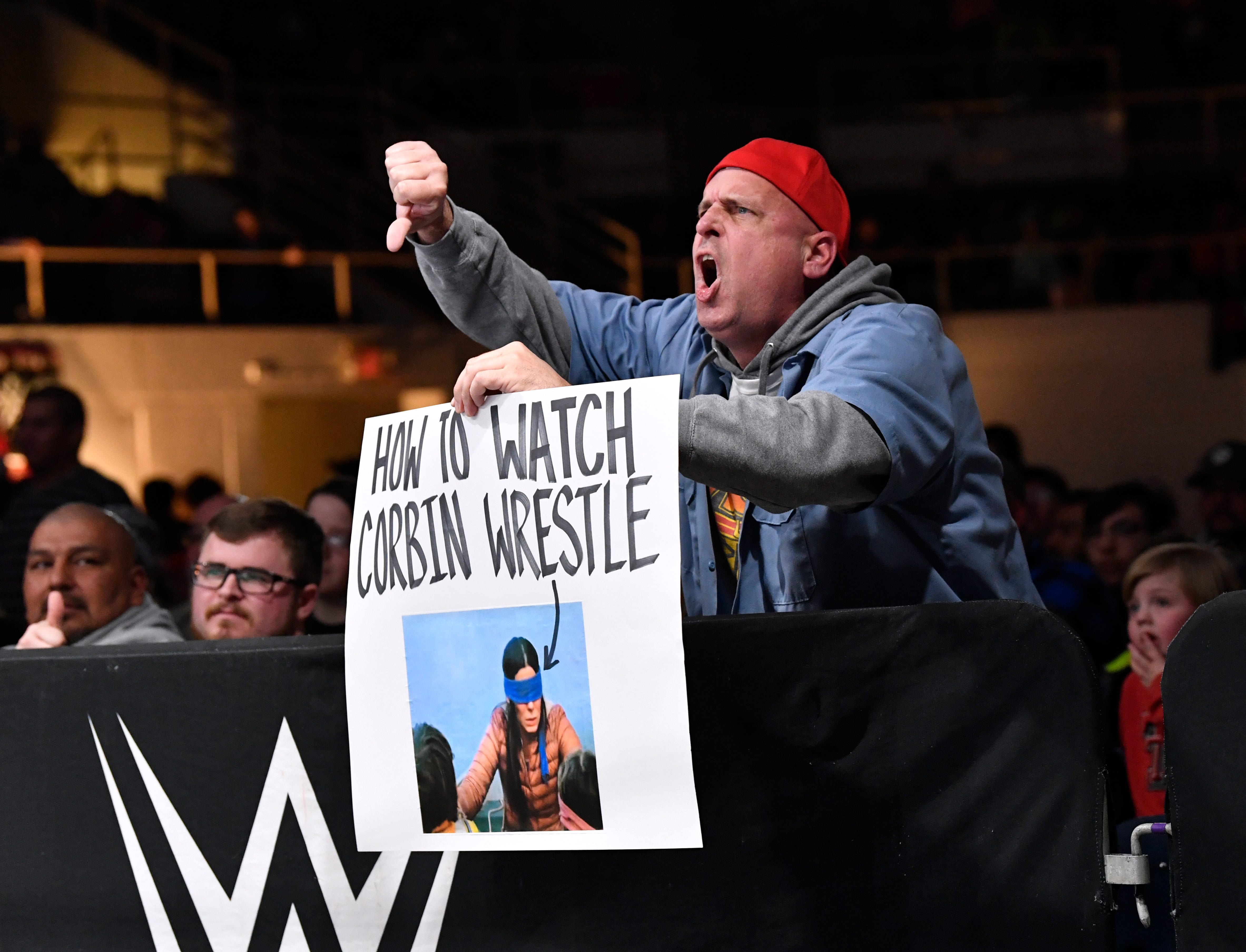 A fan taunts Baron Corbin with a homemade sign during Saturday's WWE Live wrestling event.