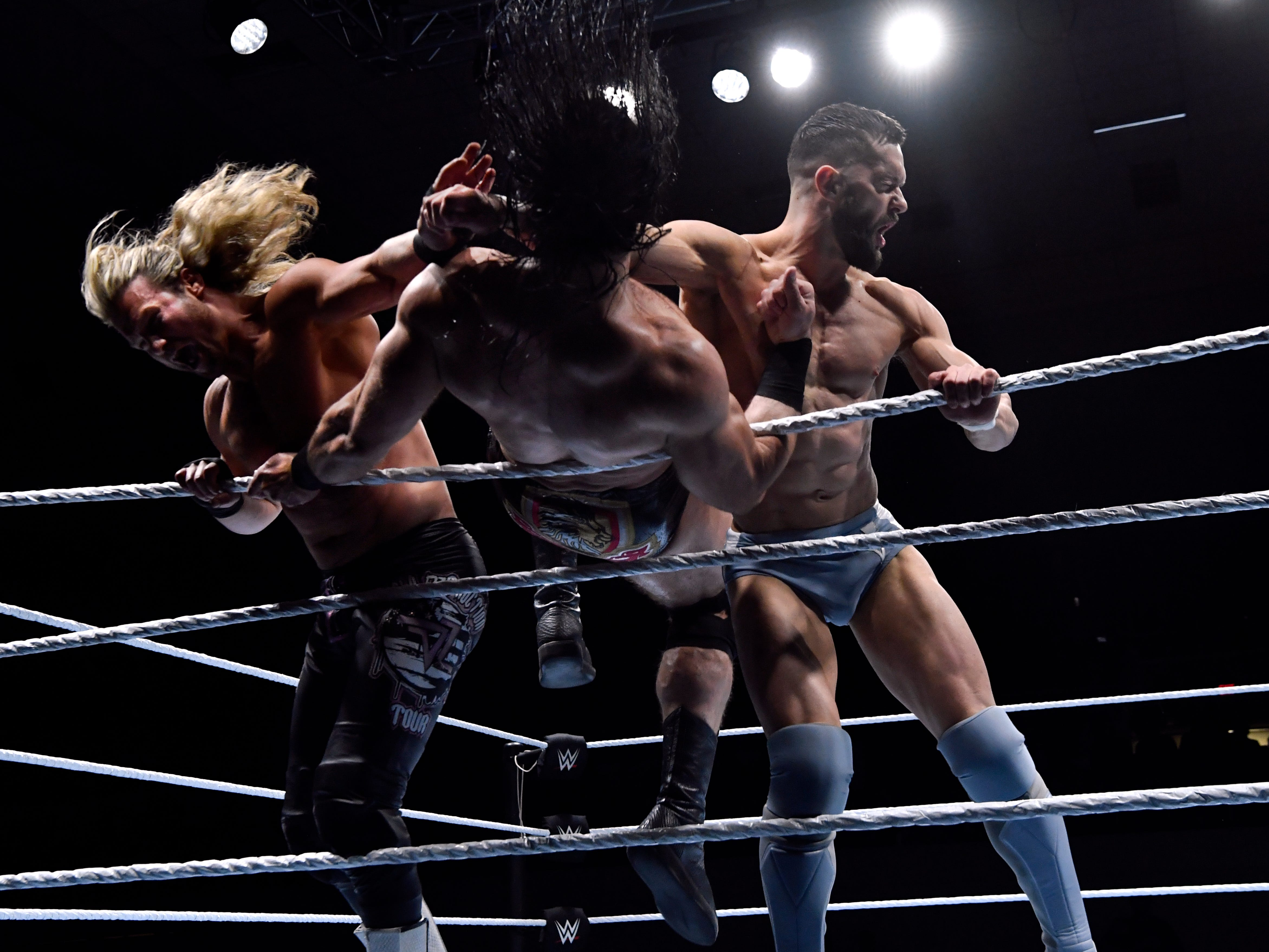 Dolph Ziggler (left) and Finn Bálor knock Drew McIntyre out of the ring during Saturday's WWE Live wrestling event Jan. 19, 2019. Held at the Taylor County Coliseum, the evening featured a colorful array of World Wrestling Entertainment stars, including Mixed Martial Arts fighter Ronda Rousey.