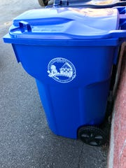 The new 95-gallon cans are designed to replace multiple plastic recycling bins town residents were previously issued.