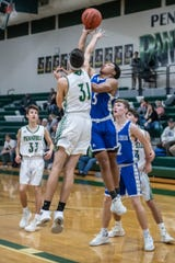 Rae'Quan Funches (No. 5) has been a bright spot for Harper Creek in his first year with the team, averaging 20 points per game.