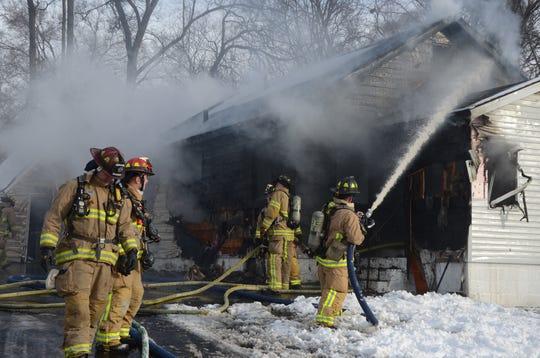 Battle Creek firefighters battle a fire at 16 Helen Montgomery Avenue on Tuesday, Jan. 22, 2019.