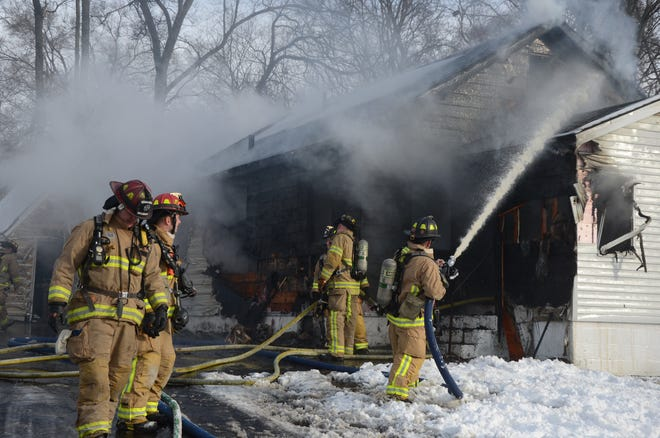 Battle Creek firefighters battle a fire at 16 Helen Montgomery Avenue on Tuesday, Jan. 22, 2019.