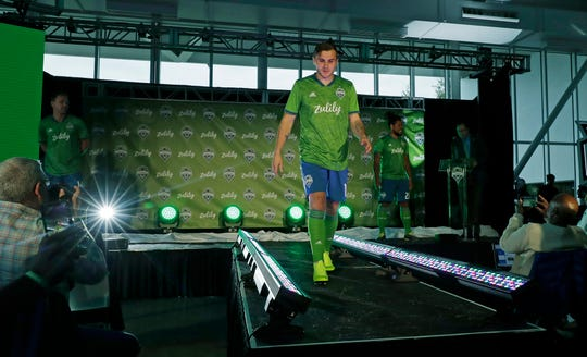 The Sounders' Jordan Morris shows off the team's new uniform last week in Seattle. Morris opened camp with the team on Tuesday after missing some 18 months of action due to injury.