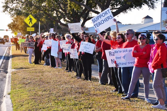 Brevard Public School teachers continue to battle with the district over pay.