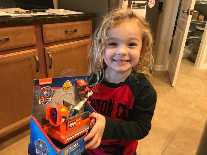 Isabella is all smiles after receiving a Paw Patrol toy during the holiday weekend.