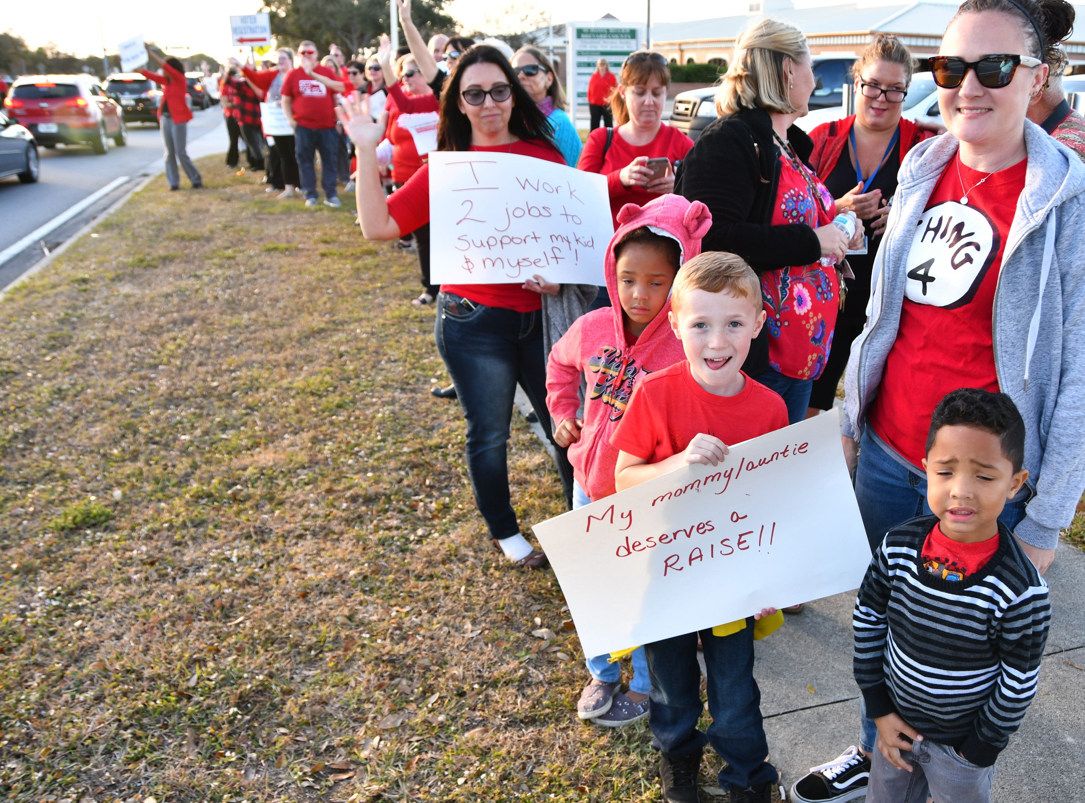 Hundreds of the Brevard Federation of Teachers union members picketed outside the school board headquarters to protest low wages before Tuesday's school board meeting. Negotiations over raises and working conditions are currently at impasse. The teachers entered the meeting en masse as the meeting started.