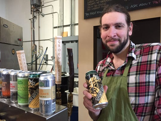 """Ricky Klein, aka """"Ricky the Meadmaker,"""" holds a can of Coffee Chaos Nitro Mead at Groennfell Meadery in Colchester in 2018."""