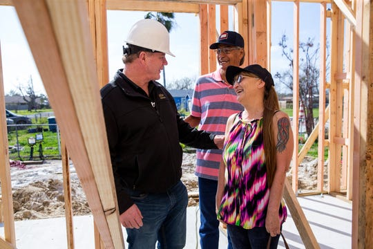 Steve Mataro (clockwise from left), owner of DSW Homes, and Juan and Juanita Rodriguez gives a tour what will be the Rodriguez' new home in about 10 days during a walkthrough showing progress on Tuesday, January 22, 2019 in Rockport. Their home was damaged by Hurricane Harvey and was beyond repair, under the Homeowner Assistance Program they are getting the help they needed to get their home rebuilt. The General Land Office has allocated more than a billion dollars to the program, which will help thousands of Texans who were affected by Hurricane Harvey recover.
