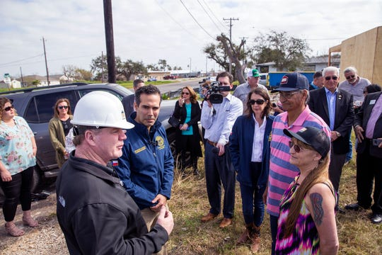 Steve Mataro (clockwise from left), owner of DSW Homes, Texas Land Commissioner George P. Bush and Juan and Juanita Rodriguez meet outside what will be the Rodriguez' new home in about 10 days during a walkthrough showing progress on Tuesday, January 22, 2019 in Rockport. Their home was damaged by Hurricane Harvey and was beyond repair, under the Homeowner Assistance Program they are getting the help they needed to get their home rebuilt. The General Land Office has allocated more than a billion dollars to the program, which will help thousands of Texans who were affected by Hurricane Harvey recover.