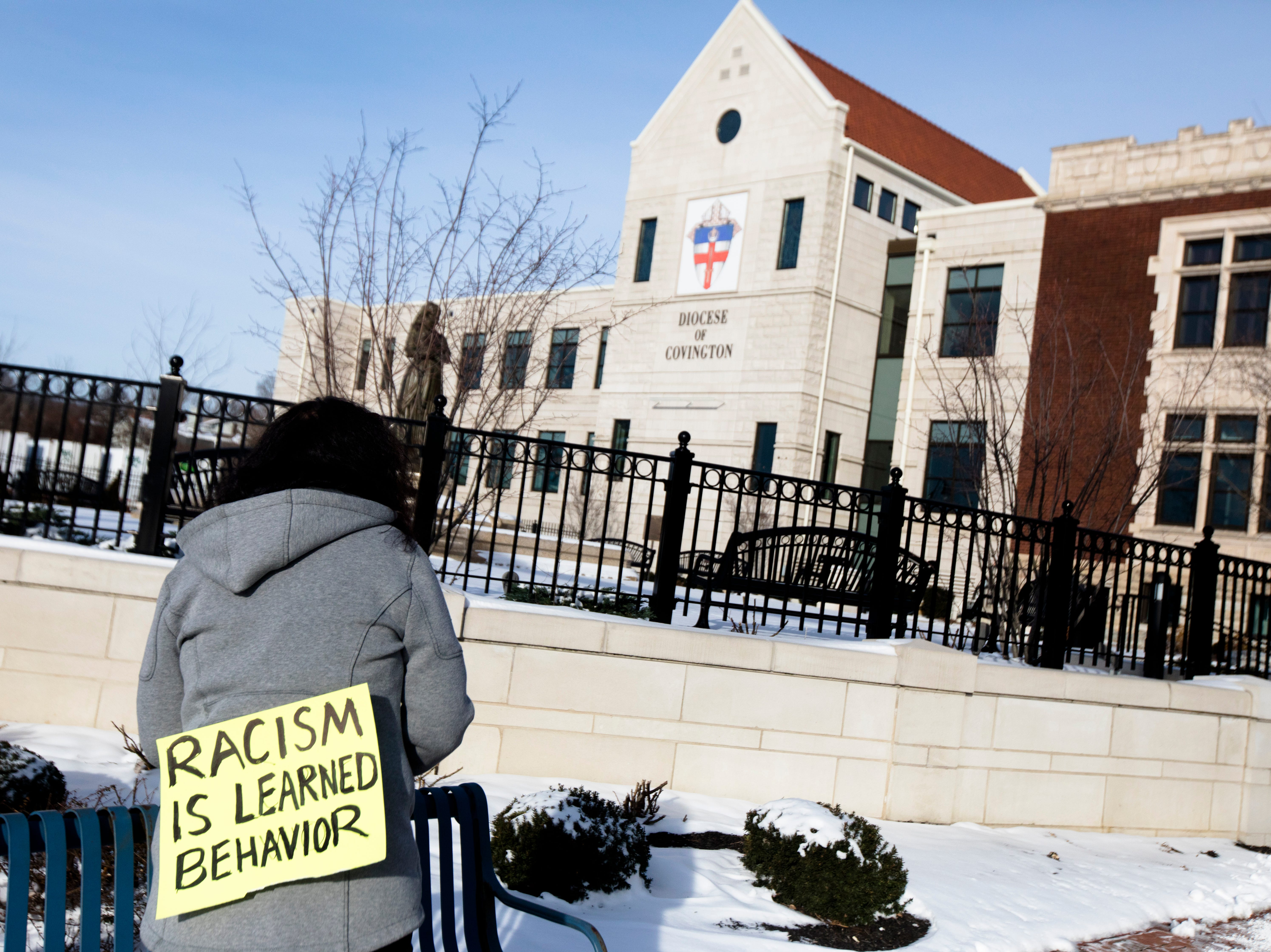 Julie Dye protests outside the Diocese of Covington building in Covington, Kentucky, on Tuesday, Jan. 22, 2019.  The protest was planned by the American Indian Movement in response to incident in Washington DC when students of Covington Catholic High School were filmed in an altercation with a Native American man.