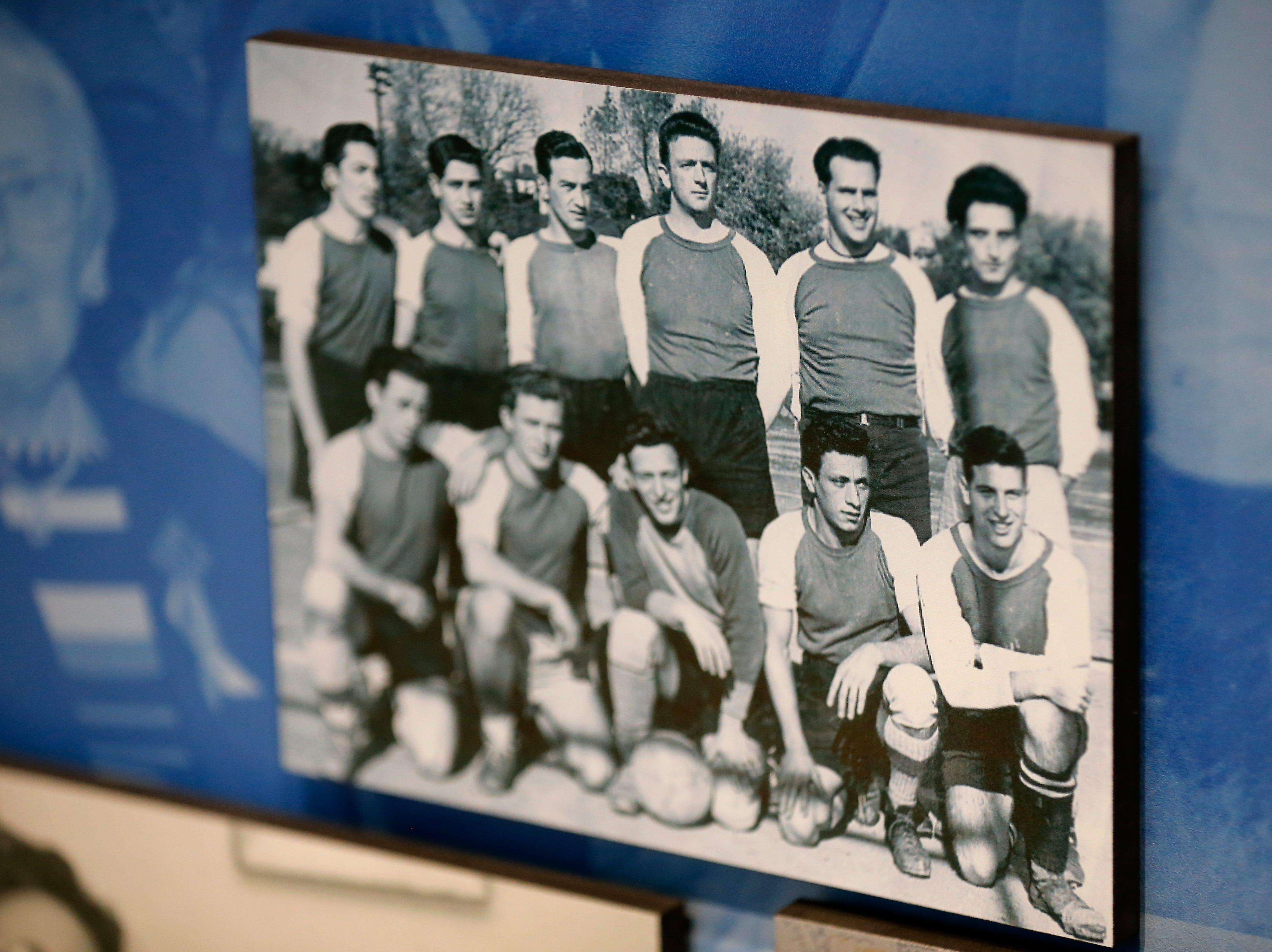 A photo of Al Miller posing with a soccer team of fellow survivors from the Cincinnati area is displayed in the new Holocaust and Humanity Center at the Cincinnati Museum Center in the Queensgate neighborhood of Cincinnati on Tuesday, Jan. 22, 2019. The new exhibit covering the events before, during and after the Holocaust will be open to the public Jan. 27.