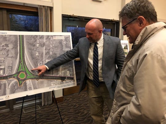 Montgomery Public Works Director Gary Heitkamp (left) discusses the roundabout planned for the intersection of Montgomery Road and the Ronald Reagan Cross County Highway with Mark Laskovics, chairman of Montgomery's Environmental Advisory Commission, at a recent open house.