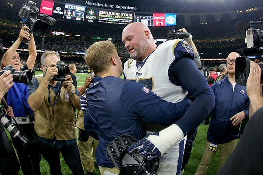Head coach Sean McVay of the Los Angeles Rams celebrates with Andrew Whitworth after defeating the New Orleans Saints in the NFC Championship game at the Mercedes-Benz Superdome on January 20, 2019 in New Orleans, Louisiana. The Los Angeles Rams defeated the New Orleans Saints with a score of 26 to 23.