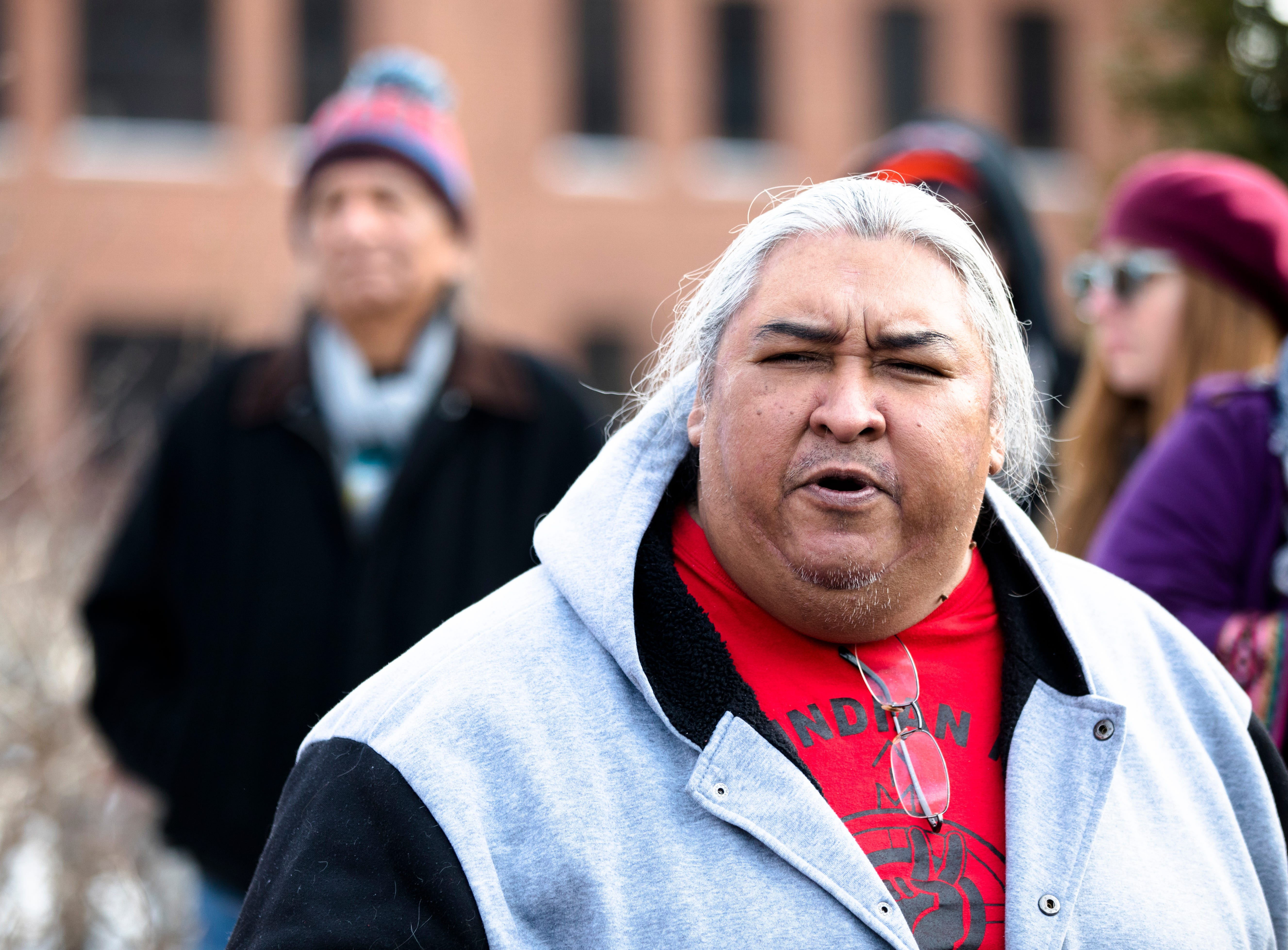 Albert Ortiz speaks during a protest of the Catholic Diocese of Covington outside the Diocese of Covington building in Covington, Kentucky, on Tuesday, Jan. 22, 2019.  The protest was planned by the American Indian Movement in response to incident in Washington DC when students of Covington Catholic High School were filmed in an altercation with a Native American man.