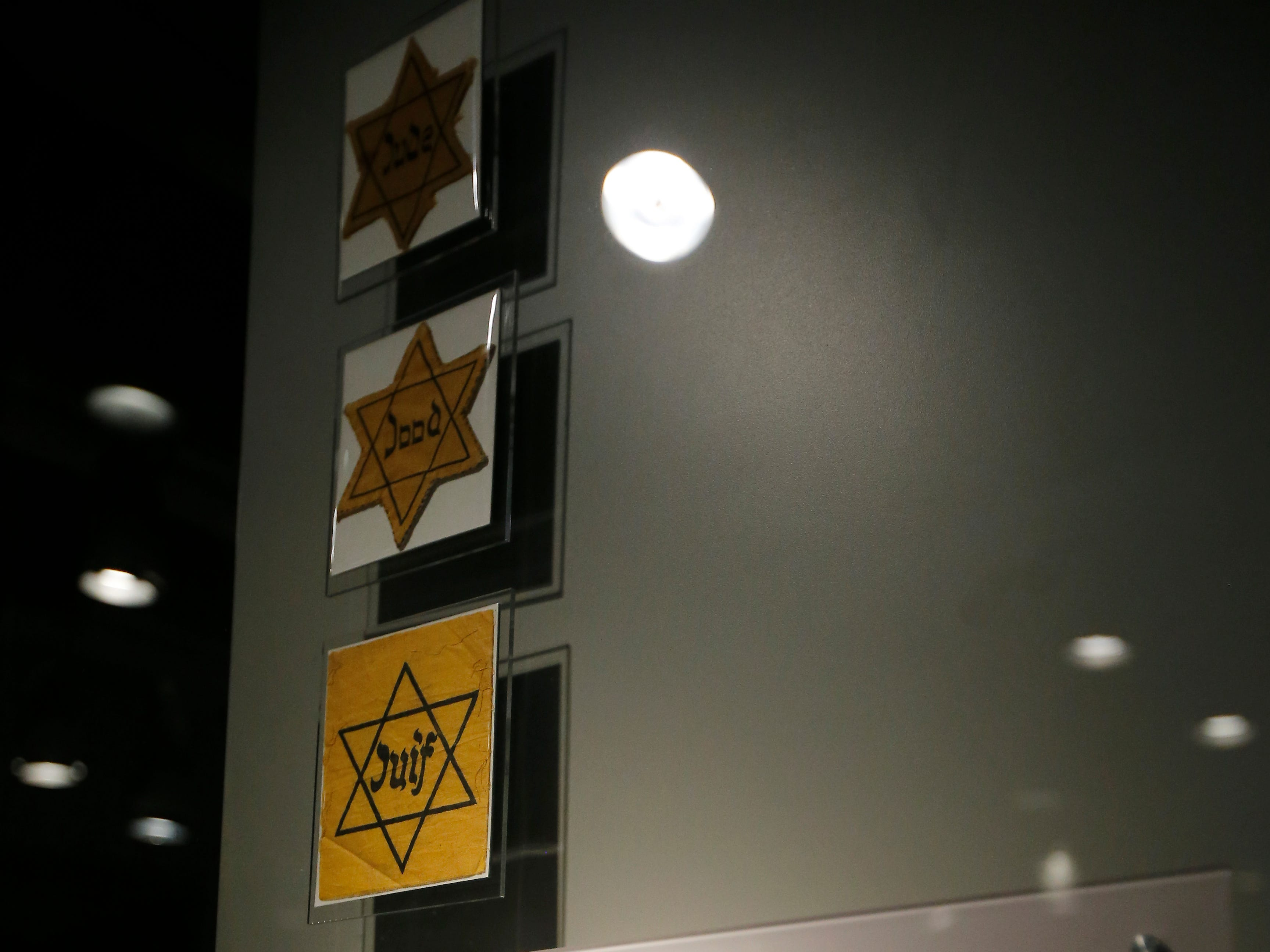 Star badges which were required to be worn by Jewish people in the Netherlands are displayed in the new Holocaust and Humanity Center at the Cincinnati Museum Center in the Queensgate neighborhood of Cincinnati on Tuesday, Jan. 22, 2019. The new exhibit covering the events before, during and after the Holocaust will be open to the public Jan. 27.