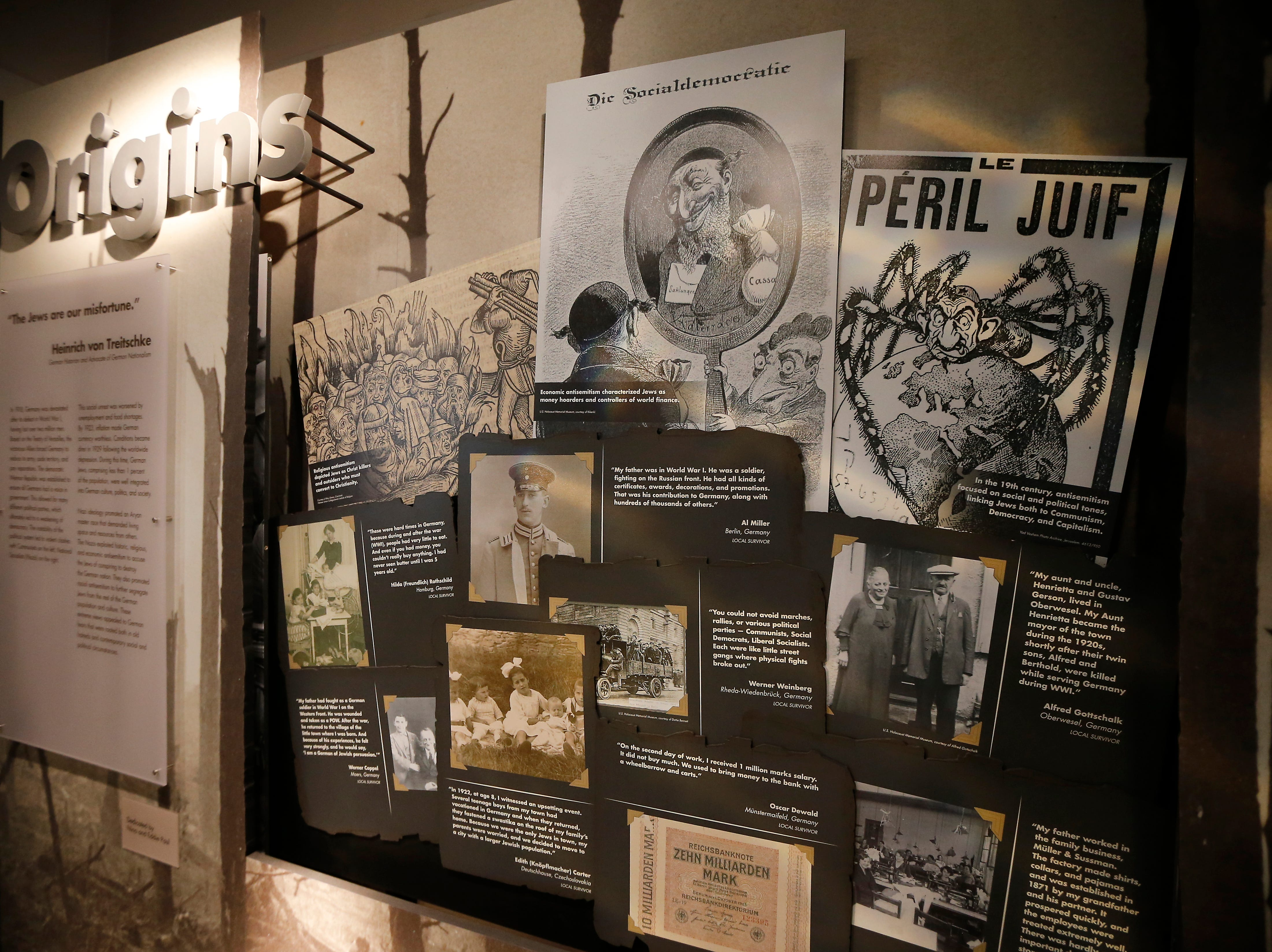 Opening panels explain origins in the new Holocaust and Humanity Center at the Cincinnati Museum Center in the Queensgate neighborhood of Cincinnati on Tuesday, Jan. 22, 2019. The new exhibit covering the events before, during and after the Holocaust will be open to the public Jan. 27.