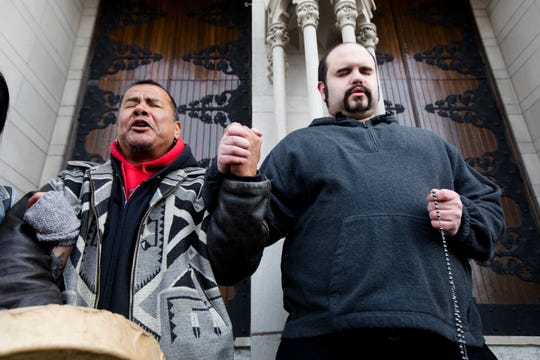 Nathan Hall, right, prays the rosary outside Cathedral Basilica of the Assumption as Sleepy Eye LaFromboise joins him in prayer during a protest of the Catholic Diocese of Covington in Covington, Kentucky, on Tuesday, Jan. 22, 2019. The protest was planned by the American Indian Movement in response to the incident in Washington, D.C., on Friday, Jan. 18, 2019.
