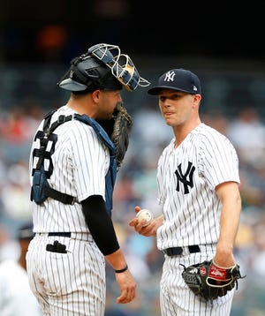 Aug 1, 2018; Bronx, NY, USA;  New York Yankees starting pitcher Sonny Gray (55) talks to  catcher Austin Romine (28) during second inning againbst Baltimore Orioles at Yankee Stadium. Mandatory Credit: Noah K. Murray-USA TODAY Sports