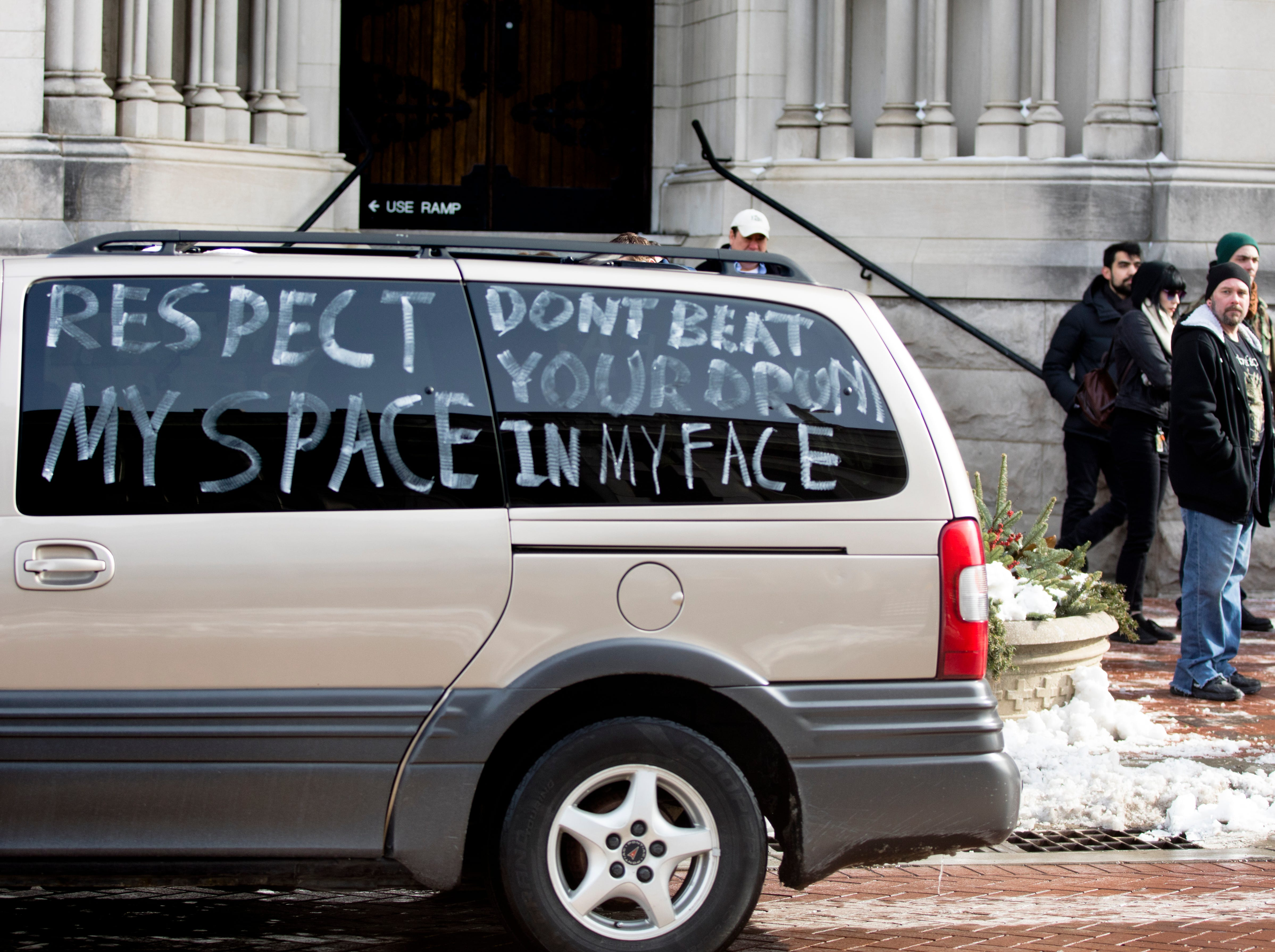 A van drives around the block during a protest of the Catholic Diocese of Covington outside the Diocese of Covington building in Covington, Kentucky, on Tuesday, Jan. 22, 2019.  The protest was planned by the American Indian Movement in response to incident in Washington DC when students of Covington Catholic High School were filmed in an altercation with a Native American man.