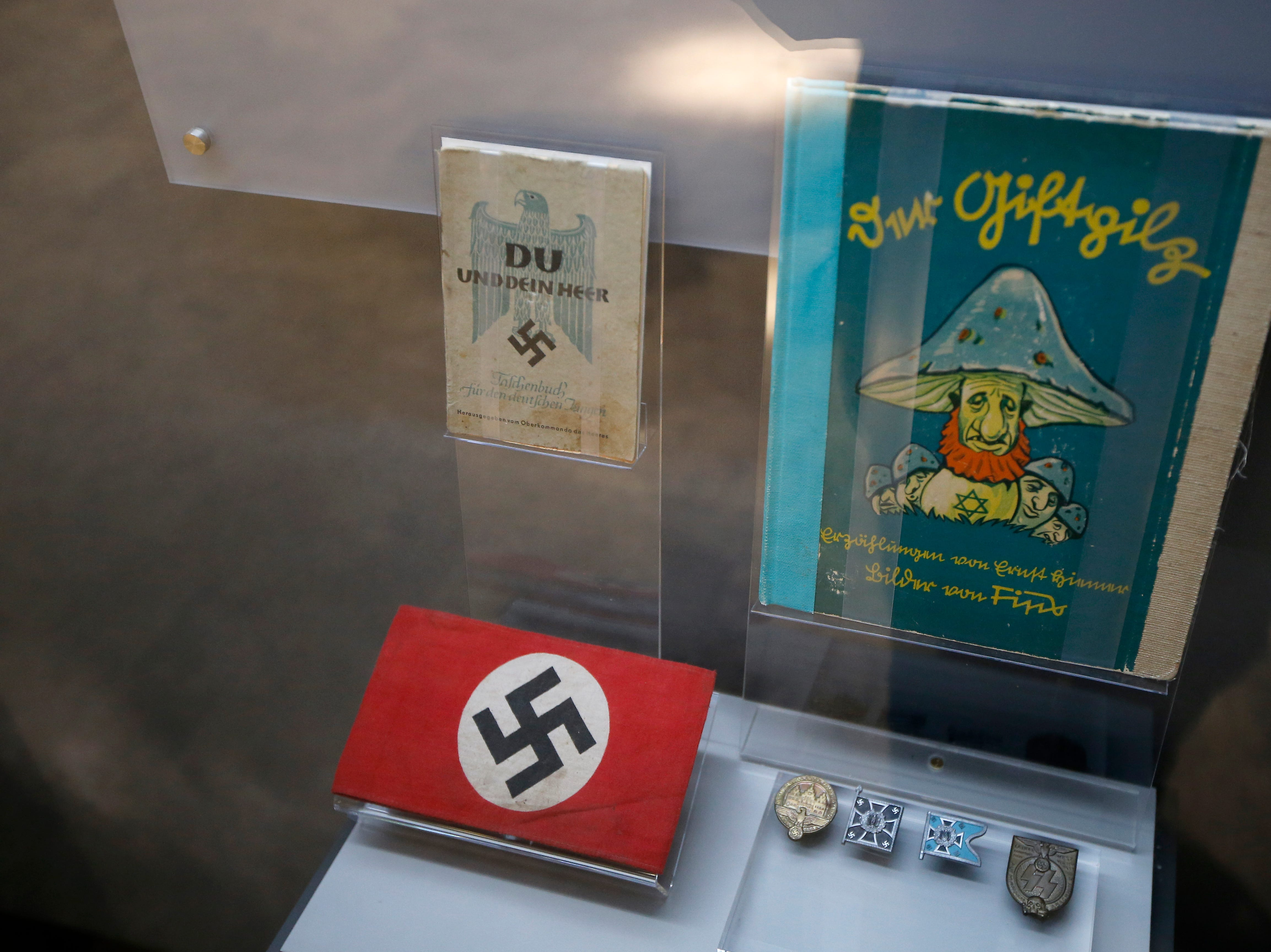 Nazi artifacts are displayed in the new Holocaust and Humanity Center at the Cincinnati Museum Center in the Queensgate neighborhood of Cincinnati on Tuesday, Jan. 22, 2019. The new exhibit covering the events before, during and after the Holocaust will be open to the public Jan. 27.