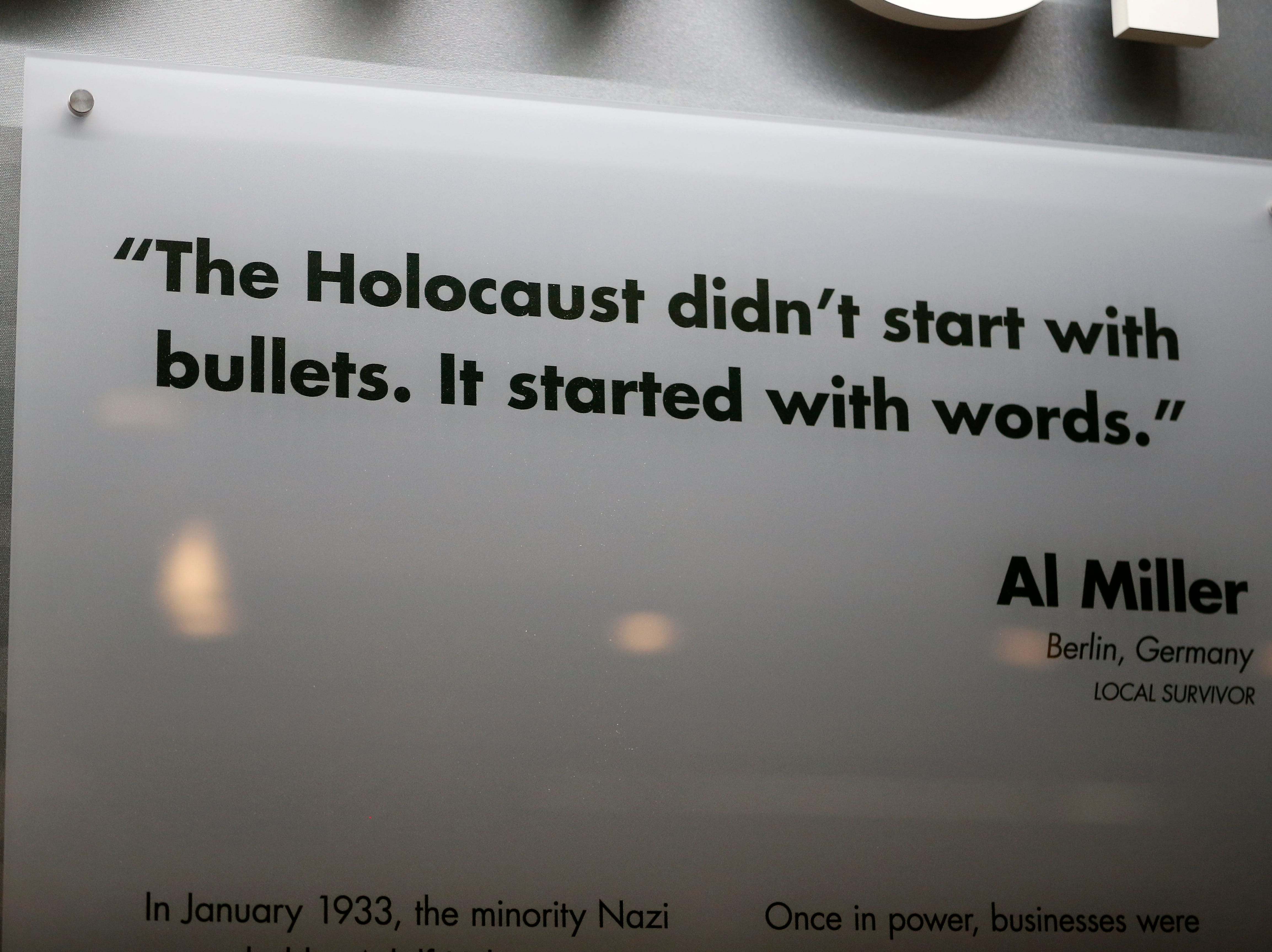 A quote from local Holocaust survivor Al Miller is displayed with background information in the new Holocaust and Humanity Center at the Cincinnati Museum Center in the Queensgate neighborhood of Cincinnati on Tuesday, Jan. 22, 2019. The new exhibit covering the events before, during and after the Holocaust will be open to the public Jan. 27.