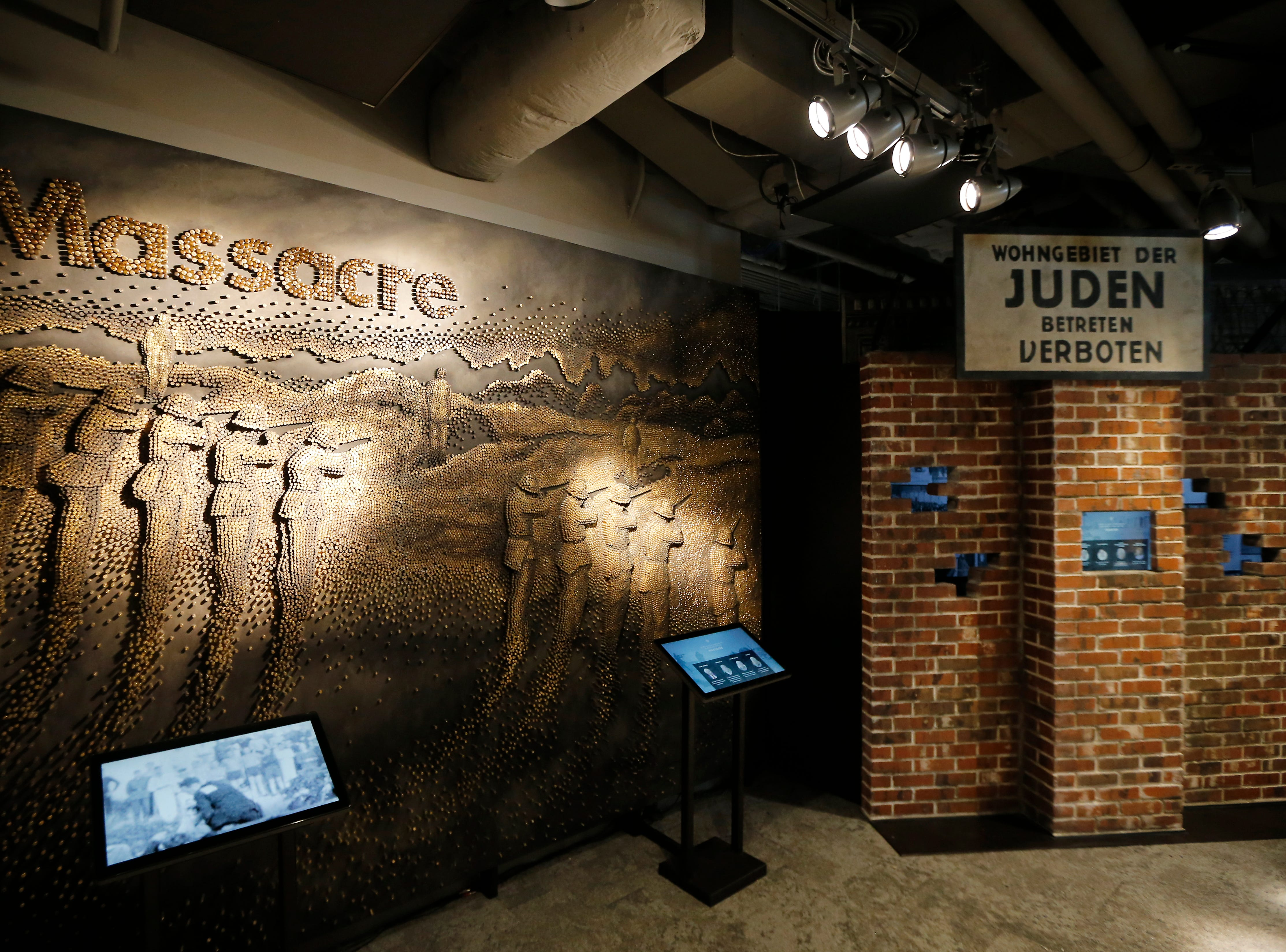 A mural depicting an execution scene is created with thousands of bullet casings in the new Holocaust and Humanity Center at the Cincinnati Museum Center in the Queensgate neighborhood of Cincinnati on Tuesday, Jan. 22, 2019. The new exhibit covering the events before, during and after the Holocaust will be open to the public Jan. 27.