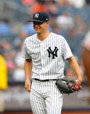 Aug 1, 2018; Bronx, NY, USA;  New York Yankees starting pitcher Sonny Gray (55) smiles as he leaves the game in the third inning against the Baltimore Orioles at Yankee Stadium. Mandatory Credit: Noah K. Murray-USA TODAY Sports